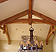 Timber trusses line vaulted ceilings